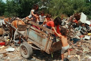 Children climb onto a horsecart in the shanty town slum (called a 'villa') where they live. Their parents collect trash to find food, and cardboard to sell to recyclers, in order to survive. Unemployment and economic collapse increased significantly in 10 years of Menem's rule.